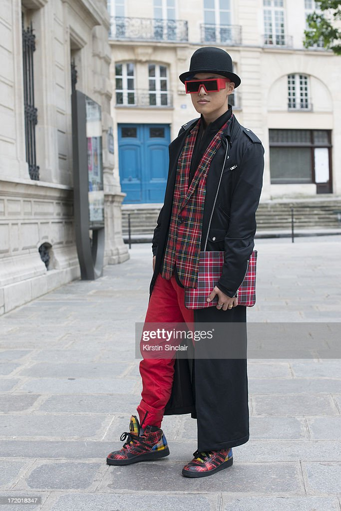 DJ, MC and Fashion blogger Peter Xu wears Adidas trainers, 5cm trousers, a Comme des Garcons jacket and tops, Rad Hourani with Mikita sunglasses, Givenchy clutch bag and a Henry Vibskov hat on day 3 of Paris Collections: Men on June 28, 2013 in Paris, France.