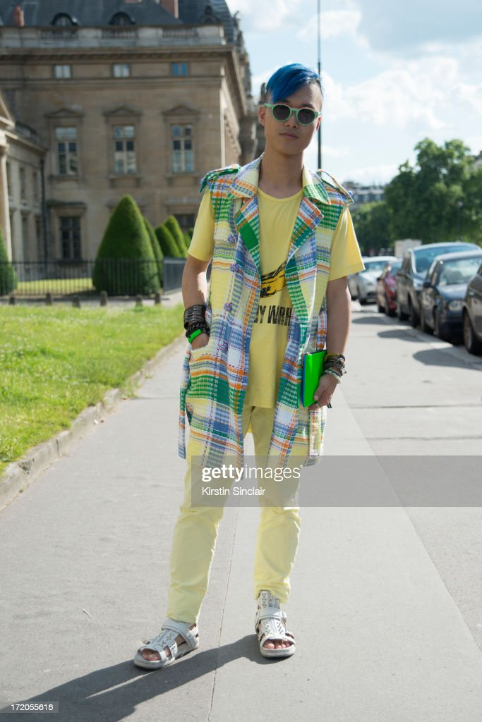 DJ, MC and Fashion blogger Peter Xu wearsThom Browne jacket, Etma sunglasses, JKJY trousers, Stella McCartney shoes, Comme des Garcons clutch bag Uniqlo t-shirt on day 5 of Paris Collections: Men on June 30, 2013 in Paris, France.