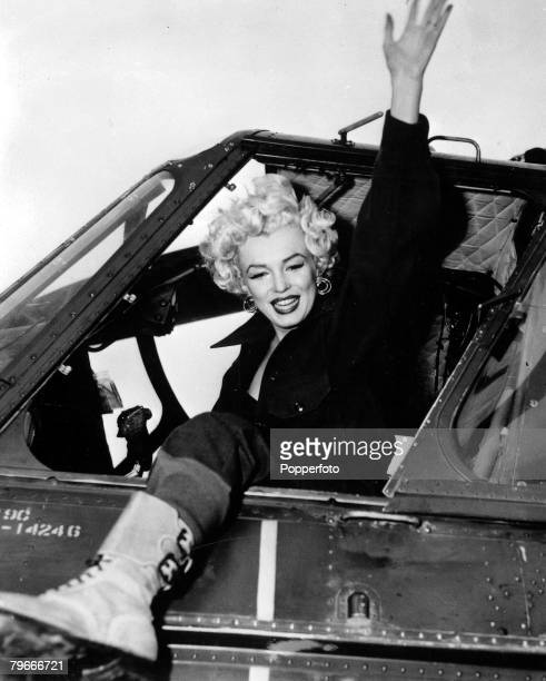 TV and Films February 1954 Korea Asia Legendary US film actress Marilyn Monroe waves from an army helicopter as she wears GI clothes including combat...