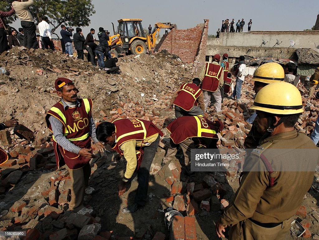 MCD and Fire dept searching , after a wall collapsed caused death of 5 children and serious injury to one child at Dallupura village near New Ashok Nagar on December 12, 2012 in New Delhi, India.