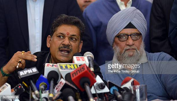MP and former cricketer Kirti Azad with veteran cricketer Bishan Singh Bedi during a press conference regarding DDCA in New Delhi