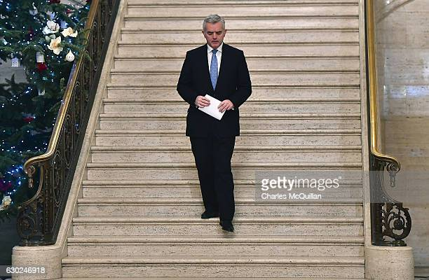 MLA and former DETI minister Jonathan Bell cuts a lonely figure as he makes his way to address the media at Stormont on December 19 2016 in Belfast...