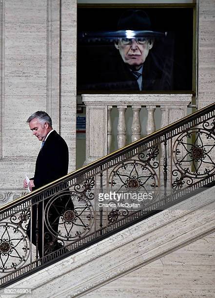 MLA and former DETI minister Jonathan Bell makes his way past a painting of the late DUP leader Ian Paisley at Stormont on December 19 2016 in...