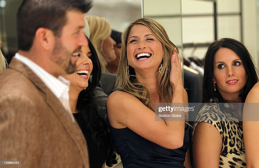 SHOE and From Fenway to the Runway, from left to right: Linda Pizzuti Henry, Catherine Panagiotopoulos and Tiffany Ortiz laugh as Catherine's fiance Jason Varitek joins them for a photo at the annual Red Sox wives fashion show at Saks Fifth Avenue in the Prudential Center.