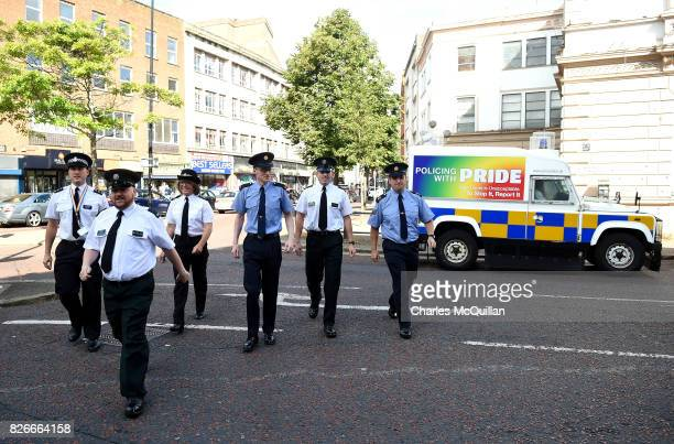 PSNI and Garda officers representative of the gay community exit a PSNI landrover before taking part in the Belfast Gay Pride parade on August 5 2017...