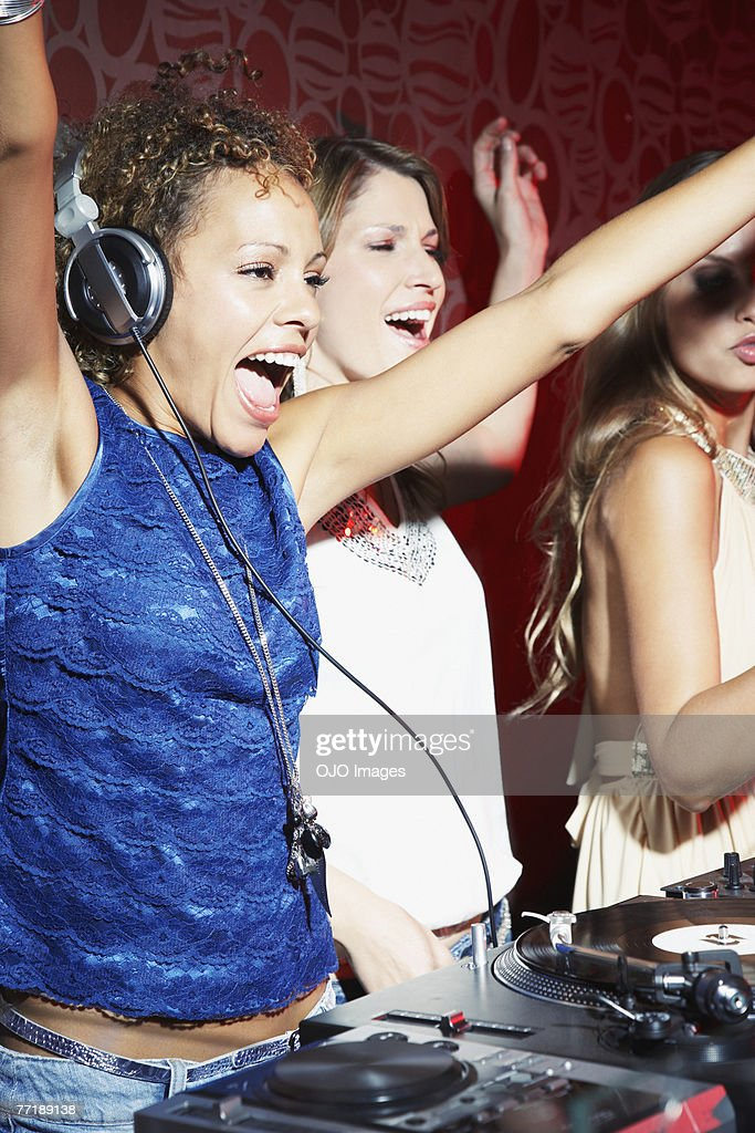 A DJ and her friends : Stock Photo