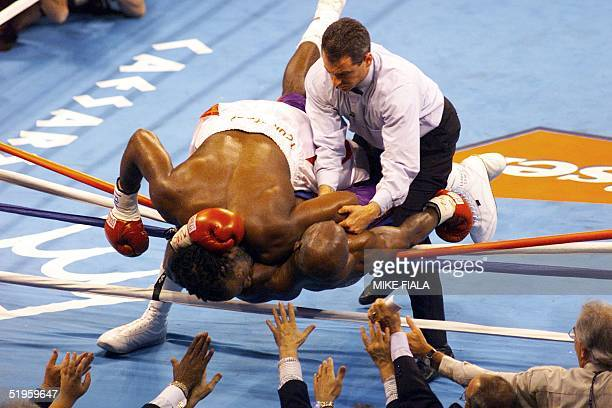 WBA and IBF Heavyweight Champion Evander Holyfield from the US is crushed under WBC Heavyweight Champion Lennox Lewis from Great Britain during the...