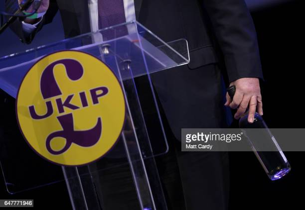 MEP and international trade spokesman William Dartmouth holds a bottle of Australian wine as he speaks at the UKIP South West regional conference at...