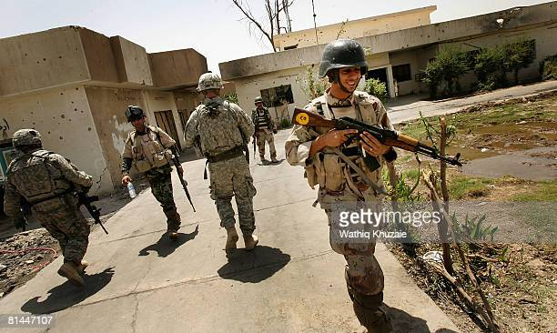 S and Iraqi Army soldiers are seen at an Iraqi army post on June 5 2008 in the alRahmaniya Shiite neighborhood north of Baghdad Iraq US Ambassador to...