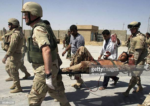 S and Iraqi soldiers evacuate an injured Iraqi soldier September 12 2005 in Tall Afar 93 miles east the Syrian border 260 miles northwest of Baghdad...