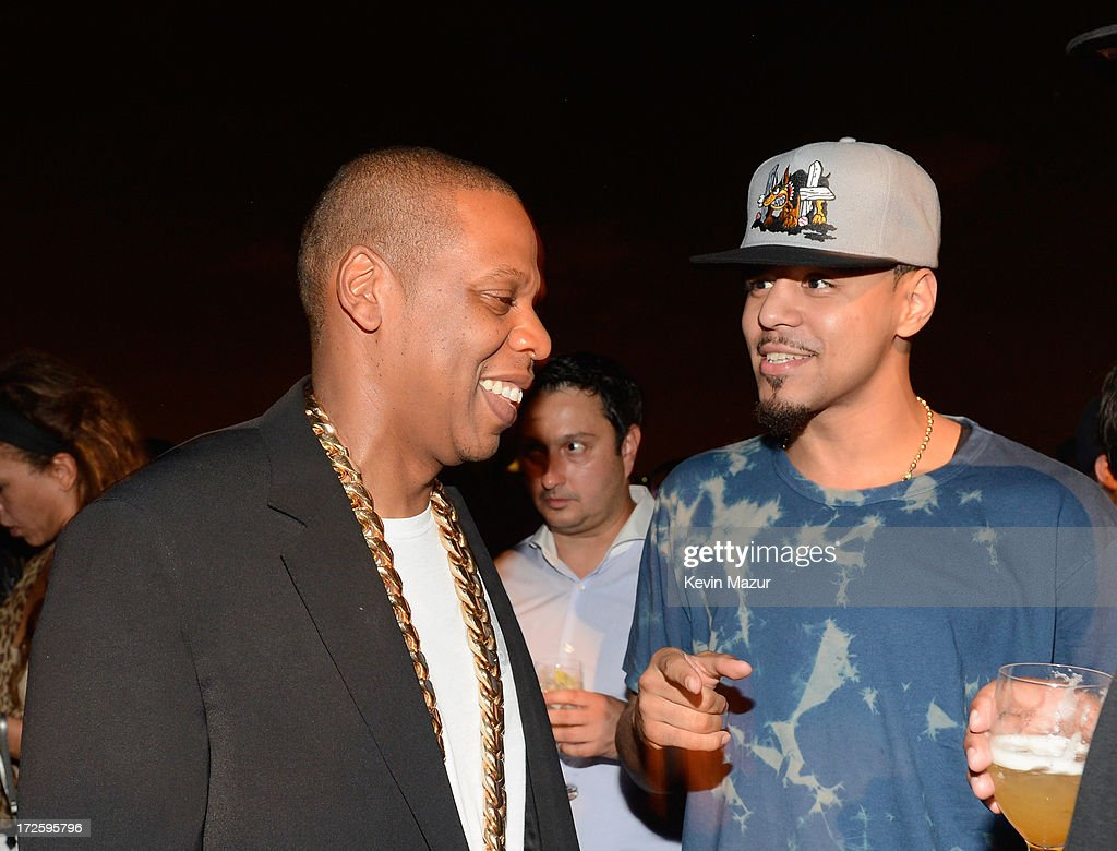 JAY Z and J. Cole attend JAY Z and Samsung Mobile's celebration of the Magna Carta Holy Grail album, available now through a customized app in Google Play and Samsung Apps exclusively for Samsung Galaxy S 4, Galaxy S III and Note II users on July 3, 2013 in Brooklyn City.
