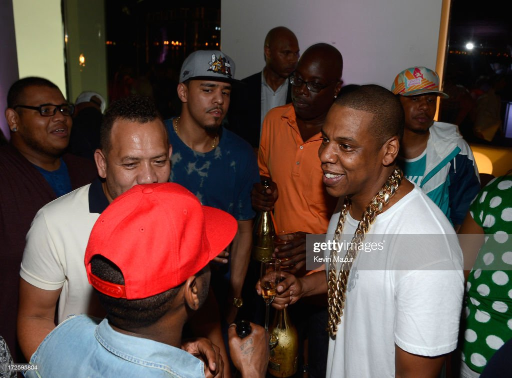 JAY Z and <a gi-track='captionPersonalityLinkClicked' href=/galleries/search?phrase=J.+Cole&family=editorial&specificpeople=5958978 ng-click='$event.stopPropagation()'>J. Cole</a> (L) attend JAY Z and Samsung Mobile's celebration of the Magna Carta Holy Grail album, available now through a customized app in Google Play and Samsung Apps exclusively for Samsung Galaxy S 4, Galaxy S III and Note II users on July 3, 2013 in Brooklyn City.