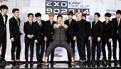 EXO and Jeon HyunMoo pose for photographs during the Mnet 'EXO 902014' press conference at CJ EM center on August 11 2014 in Seoul South Korea