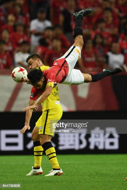 DIAMONDS and JUNYA ITO OF KASHIWA REYSOL compete for the ball during the JLeague J1 match between Urawa Red Diamonds and Kashiwa Reysol at Saitama...