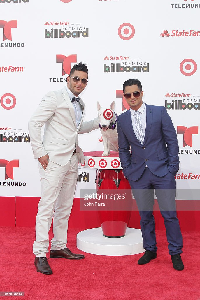 RKM and KEN Y celebrate with Bullseye, Target's Beloved Bull Terrier Mascot, at the 2013 Billboard Latin Music Awards at BankUnited Center on April 25, 2013 in Miami, Florida.