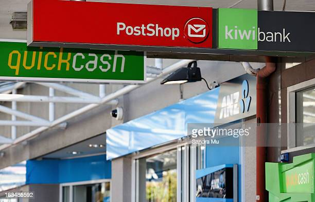 ANZ and Kiwi bank signage is seen after a press conference announcing the class suit to reclaim bank fees on March 11 2013 in Auckland New Zealand...