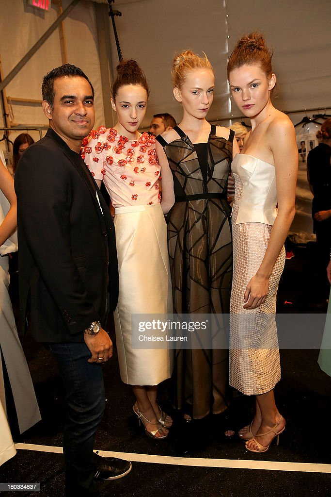 LOOK #7, LOOK #18 and LOOK #8 worn by models seen backstage with designer Bibhu Mohapatra at his fashion show during Mercedes-Benz Fashion Week Spring 2014 in the Studio at Lincoln Center on September 11, 2013 in New York City.