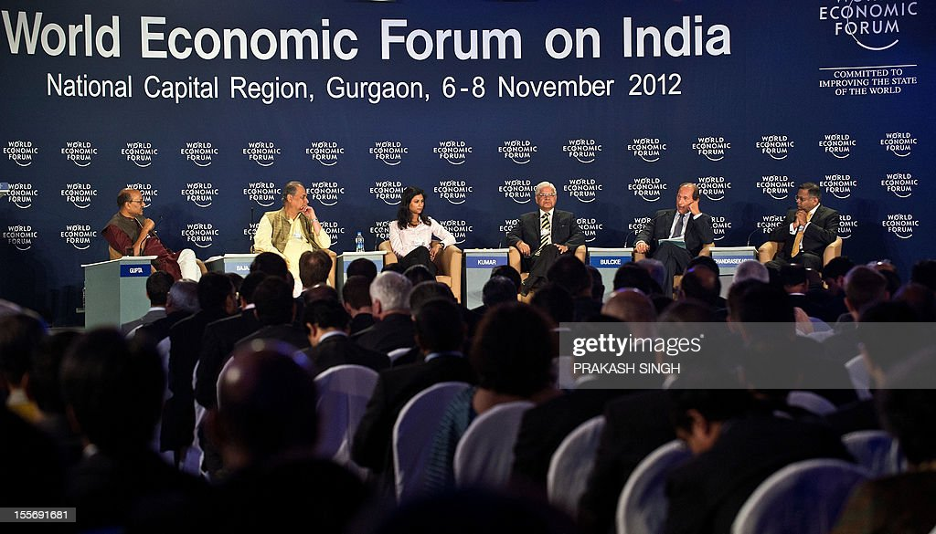 CEO and Managing Director of Tata Consultancy Services India Natarajan Chandrasekaran (R), Indian Law Minister Ashwani Kumar (3R), Professor of Economics, Harvard University USA Gita Gopinath (3L), Chairman Bajaj Auto Rahul Bajaj (2L) and Indian Express Editor Shekhar Gupta (L) listen to CEO of Nestle Switzerland and Co-Chair of the World Economic Forum on India Paul Bulcke (2R) during the World Economic Forum summit in Gurgaon on November 7, 2012. Canadian Prime Minister Stephen Harper and Britain's former Premier Gordon Brown are among the top draws along with other corporate honchos at the three-day Indian edition of World Economic Forum. AFP PHOTO/ Prakash SINGH