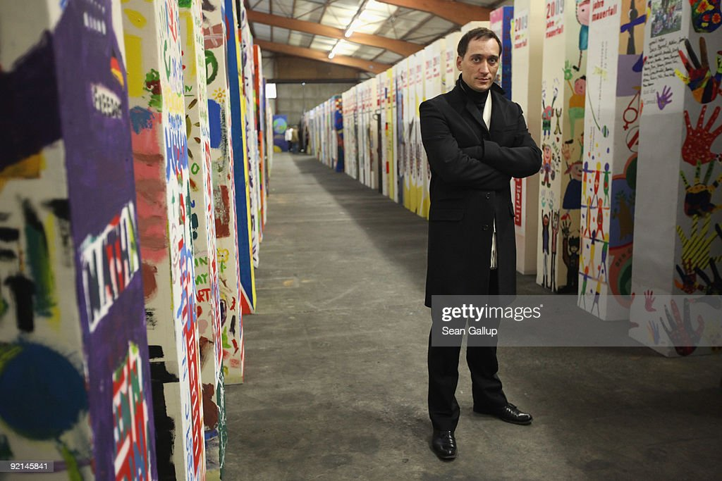 DJ and music producer Paul van Dyk poses among giant styrofoam'dominos' that will be used to commemorate the fall of the Berlin Wall and that are...
