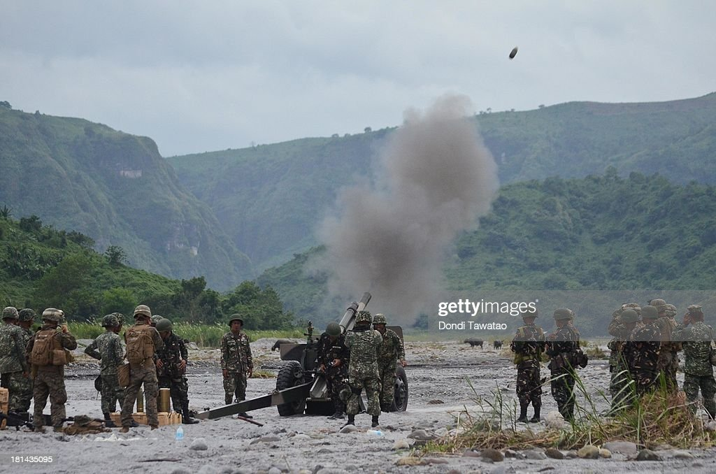 S. and Philippine Marines fire a 105mm howitzer round during a military training exercise in Crow Valley, September 21, 2013 in Tarlac province, Philippines. Around three thousand U.S. Marines are in the country for the Phiblex amphibious marine exercise with their Philippine counterparts. The war games maneuvers run for three weeks in various locations in the Philippines.
