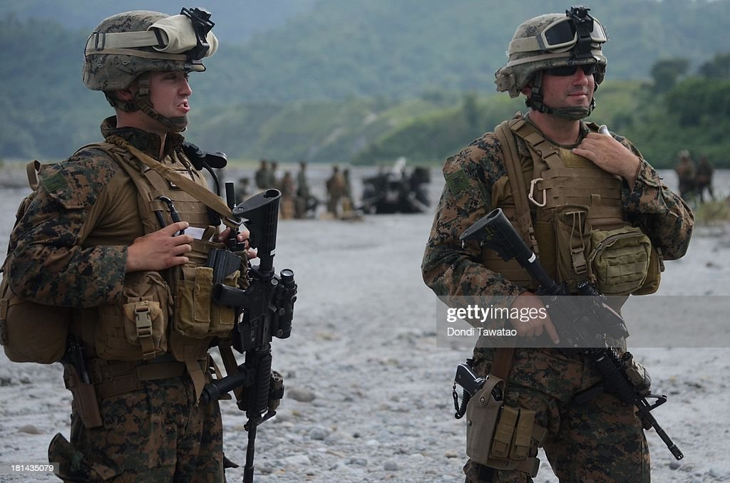 S. and Philippine Marines take part in a military training exercise in Crow Valley, September 21, 2013 in Tarlac province, Philippines. Around three thousand U.S. Marines are in the country for the Phiblex amphibious marine exercise with their Philippine counterparts. The war games maneuvers run for three weeks in various locations in the Philippines.