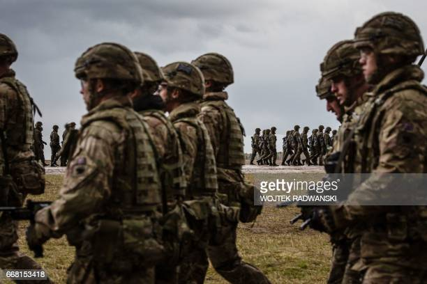 US and Polish troops take part in the official welcoming ceremony for NATO troops part of The Enhanced Forward Presence in Orzysz Poland April 13...