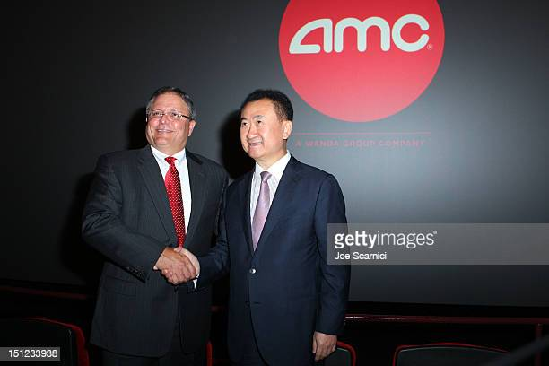 CEO and President of AMC Entertainment Inc Gerry Lopez and Board Chairman and President of Dalian Wanda Group Co Ltd Wang Jianlin speak at the Wanda...
