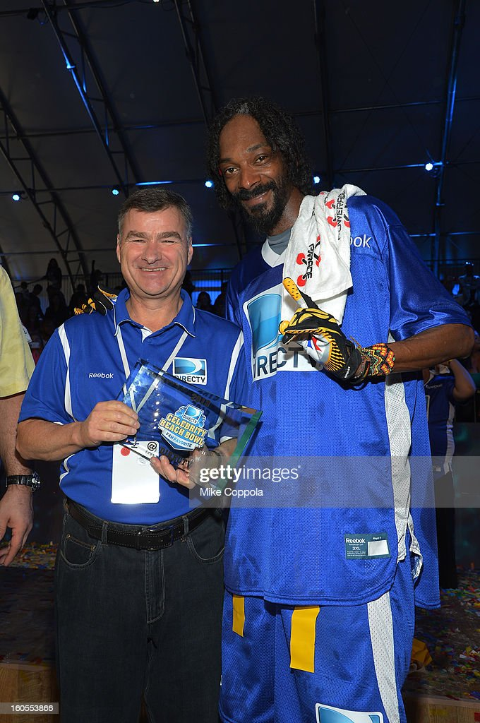 CEO and President of DIRECTV Michael White and rapper <a gi-track='captionPersonalityLinkClicked' href=/galleries/search?phrase=Snoop+Dogg&family=editorial&specificpeople=175943 ng-click='$event.stopPropagation()'>Snoop Dogg</a> attend DIRECTV'S Seventh Annual Celebrity Beach Bowl at DTV SuperFan Stadium at Mardi Gras World on February 2, 2013 in New Orleans, Louisiana.
