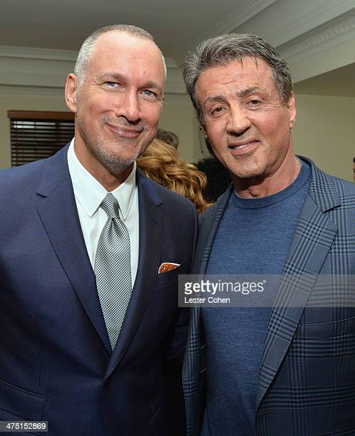VP and Publisher of Vanity Fair Edward Menicheschi and actor Sylvester Stallone attend The Annie Leibovitz SUMOSize Book Launch presented by Vanity...