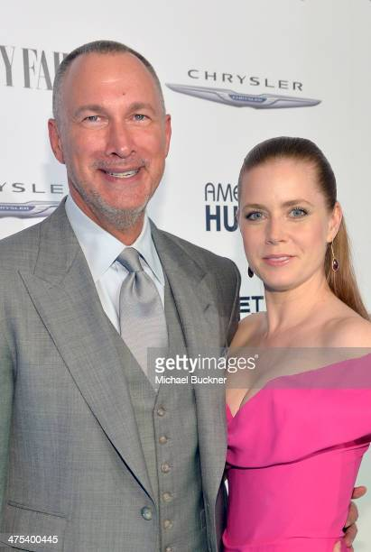VP and Publisher of Vanity Fair Edward Menicheschi and actress Amy Adams attend Vanity Fair and Chrysler Toast American Hustle during Vanity Fair...