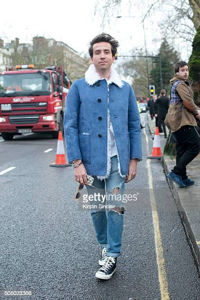 TV and radio presenter Nick Grimshaw wears a Burberry jacket and Converse trainers on day 4 of London Collections Men on Januay 11 2016 in London...