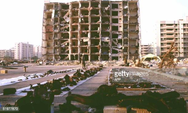 US and Saudi officials spread debris 29 June on plastic sheets as they continue to gather evidence in the 25 June bombing outside the Khobar Towers...