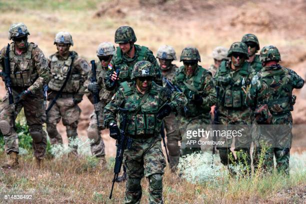 US and Serbian soldiers take part in a joint military drill 'Peace Sentinel 2017' with Bulgarian soldiers at Koren military training ground South...
