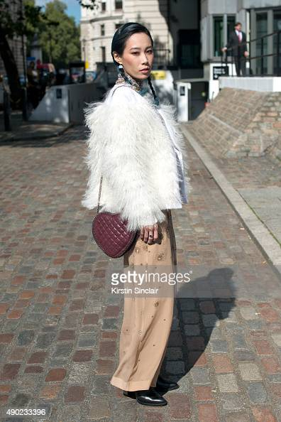 DJ and Singer Mademoiselle Yulia wears a Burberry jacket Topshop dress Toga boots and Stella McCartney bag on day 3 during London Fashion Week...