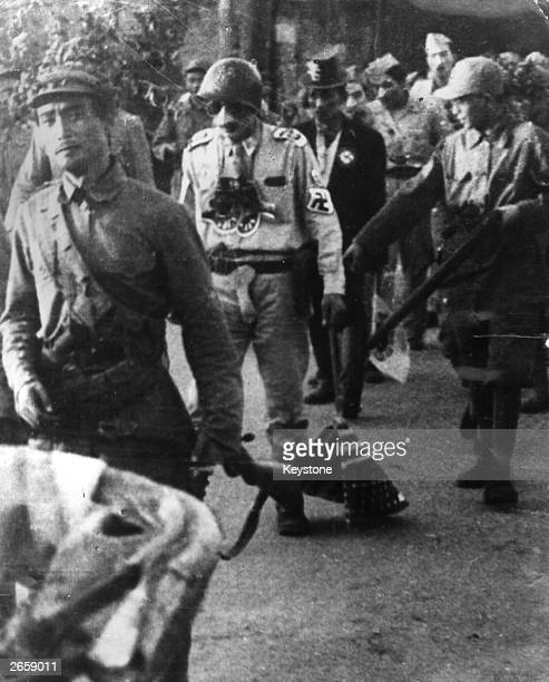 US and South Korean prisoners of war are paraded through the streets of P'yongyang by communist troops during the Korean War The US officer in the...