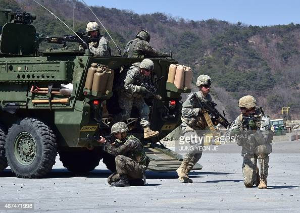 US and South Korean soldiers exit a US Stryker armoured combat vehicle during a combined arms livefire drill at the Rodriquez MultiPurpose Range...