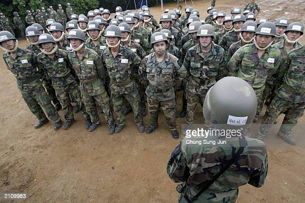 S and South Korean soldiers participate in a joint ranger training exercise at a ranger camp near the demilitarised zone June 25 2003 in Paju South...