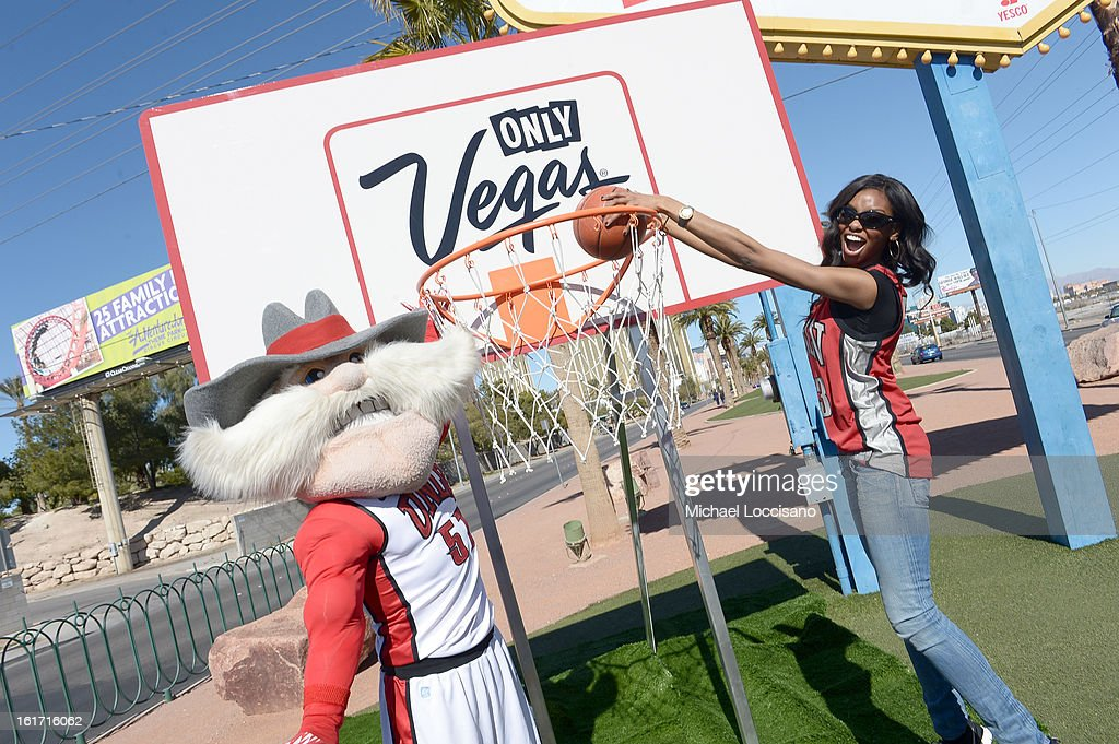 LVCVA and Sports Illustrated Model Adaora support the NCAA Basketball Conference Championship at the historic Las Vegas sign on February 14, 2013 in Las Vegas, Nevada.