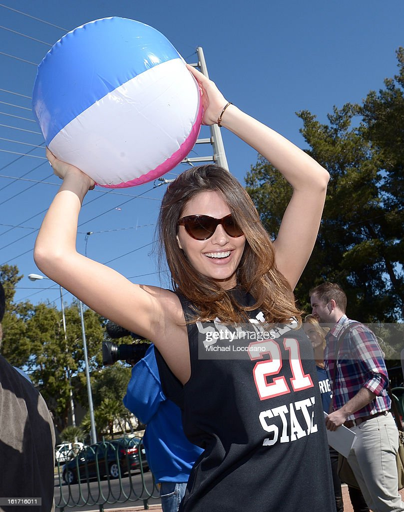 LVCVA and Sports Illustrated Model Alyssa Miller support the NCAA Basketball Conference Championship at the historic Las Vegas sign on February 14, 2013 in Las Vegas, Nevada.