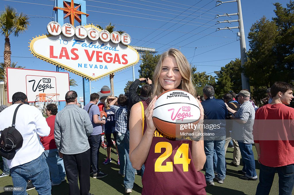LVCVA and Sports Illustrated Model Julie Henderson support the NCAA Basketball Conference Championship at the historic Las Vegas sign on February 14, 2013 in Las Vegas, Nevada.