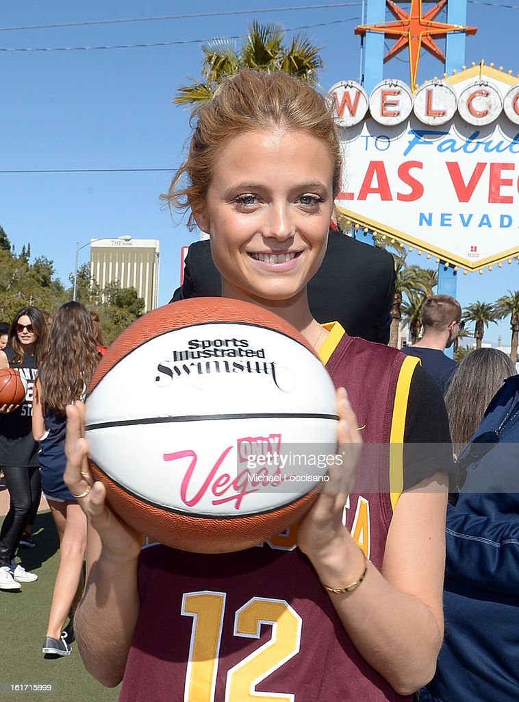LVCVA and Sports Illustrated Model Kate Bock support the NCAA Basketball Conference Championship at the historic Las Vegas sign on February 14, 2013 in Las Vegas, Nevada.