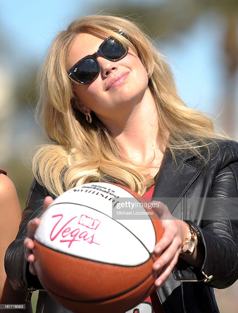 LVCVA and Sports Illustrated Model <a gi-track='captionPersonalityLinkClicked' href=/galleries/search?phrase=Kate+Upton&family=editorial&specificpeople=7488546 ng-click='$event.stopPropagation()'>Kate Upton</a> support the NCAA Basketball Conference Championship at the historic Las Vegas sign on February 14, 2013 in Las Vegas, Nevada.