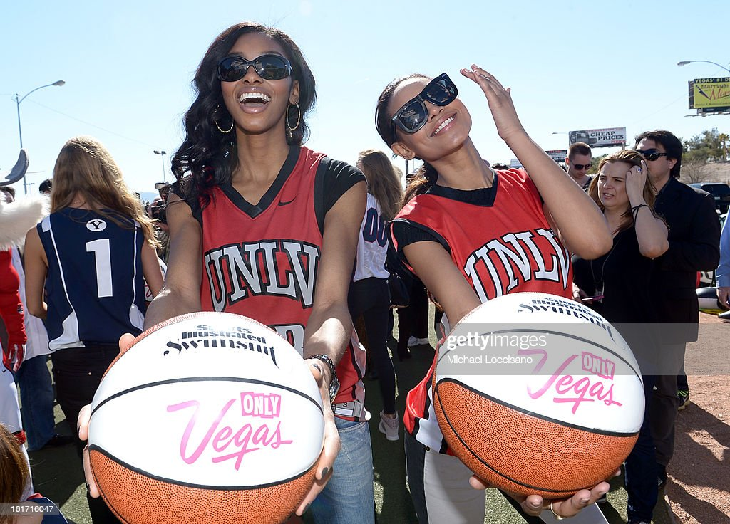 LVCVA and Sports Illustrated Models Adaora (L) and Ariel Meredith support the NCAA Basketball Conference Championship at the historic Las Vegas sign on February 14, 2013 in Las Vegas, Nevada.