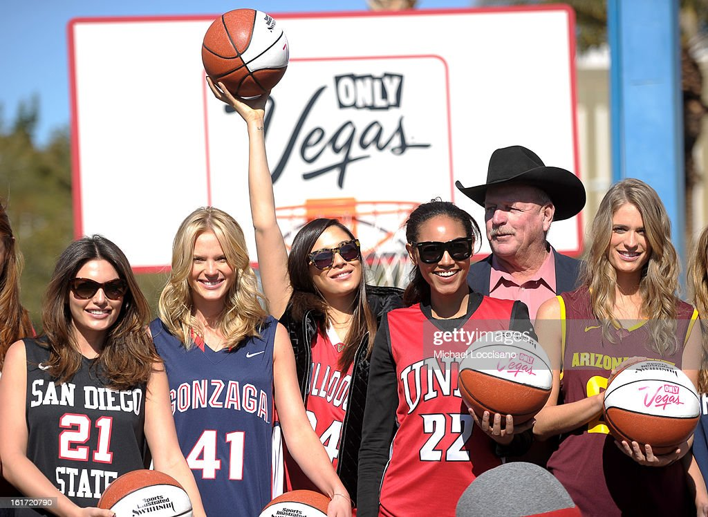LVCVA and Sports Illustrated Models (L-R) Alyssa Miller, Anne V, Jessica Gomes, Ariel Meredith and Julie Henderson support the NCAA Basketball Conference Championship at the historic Las Vegas sign on February 14, 2013 in Las Vegas, Nevada.