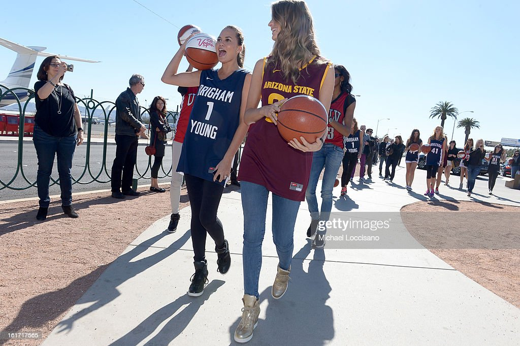 LVCVA and Sports Illustrated Models Chrissy Teigen and Julie Henderson support the NCAA Basketball Conference Championship at the historic Las Vegas sign on February 14, 2013 in Las Vegas, Nevada.