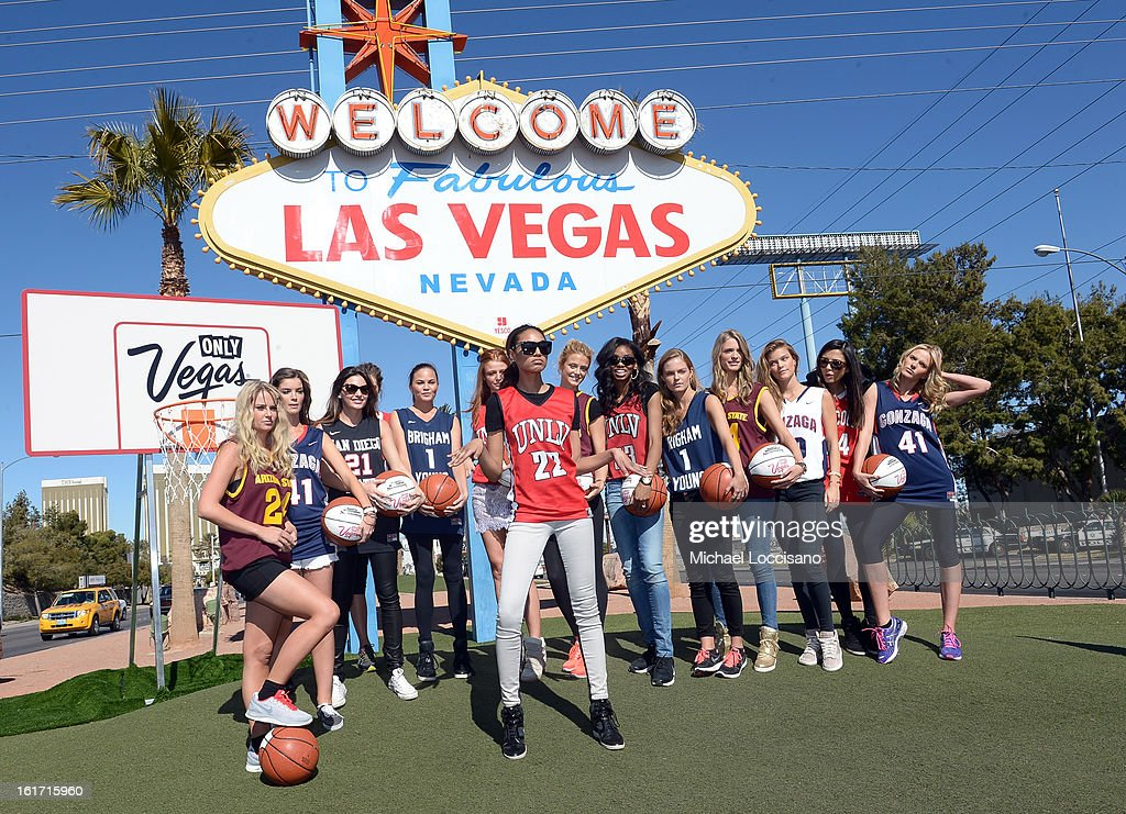 LVCVA and Sports Illustrated Models (L-R) Genevieve Morton, Natasha Barnard, Alyssa Miller, Chrissy Teigen, Cintia Dicker, Ariel Meredith, Kate Bock, Adaora, Jessica Perez, Julie Henderson, Nina Agdal, Jessica Gomes and Anne V support the NCAA Basketball Conference Championship at the historic Las Vegas sign on February 14, 2013 in Las Vegas, Nevada.
