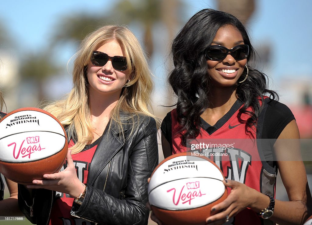 LVCVA and Sports Illustrated Models Kate Upton and Adaora support the NCAA Basketball Conference Championship at the historic Las Vegas sign on February 14, 2013 in Las Vegas, Nevada.
