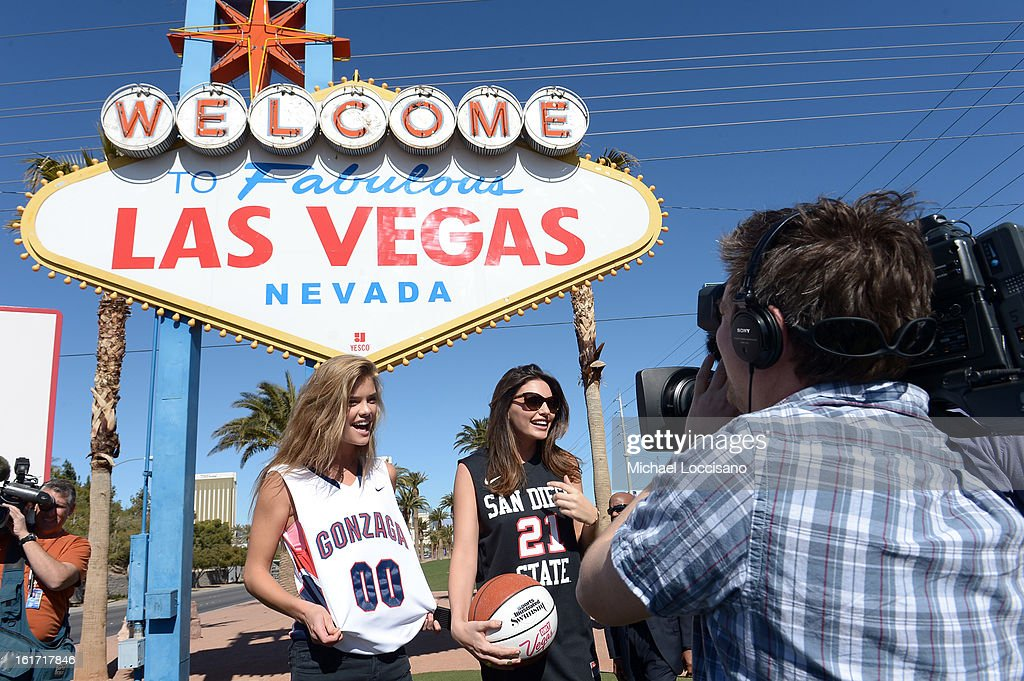 LVCVA and Sports Illustrated Models Nina Agda (L) and Alyssa Miller support the NCAA Basketball Conference Championship at the historic Las Vegas sign on February 14, 2013 in Las Vegas, Nevada.