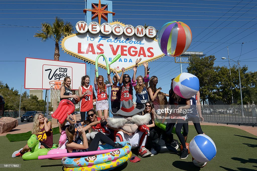 LVCVA and Sports Illustrated Models support the NCAA Basketball Conference Championship at the historic Las Vegas sign on February 14, 2013 in Las Vegas, Nevada.
