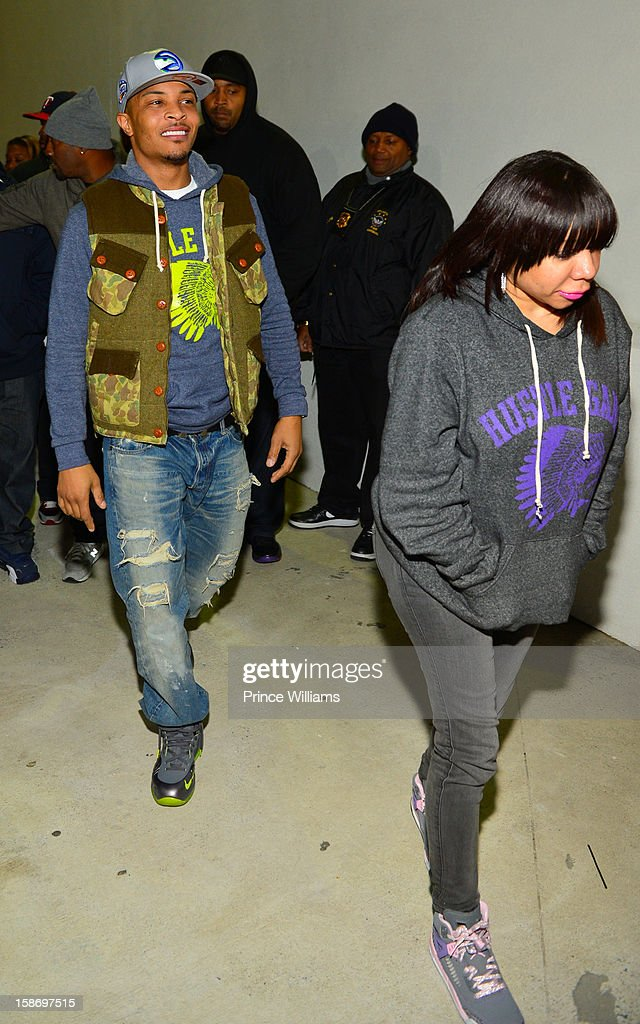 T.I. and Tameka Harris (R) attend T.I. 'Trouble Man Heavy Is The Head' Album Release Party at Compound on December 22, 2012 in Atlanta, Georgia.